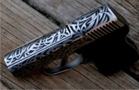 Tribal style engraving on NAA Guardian